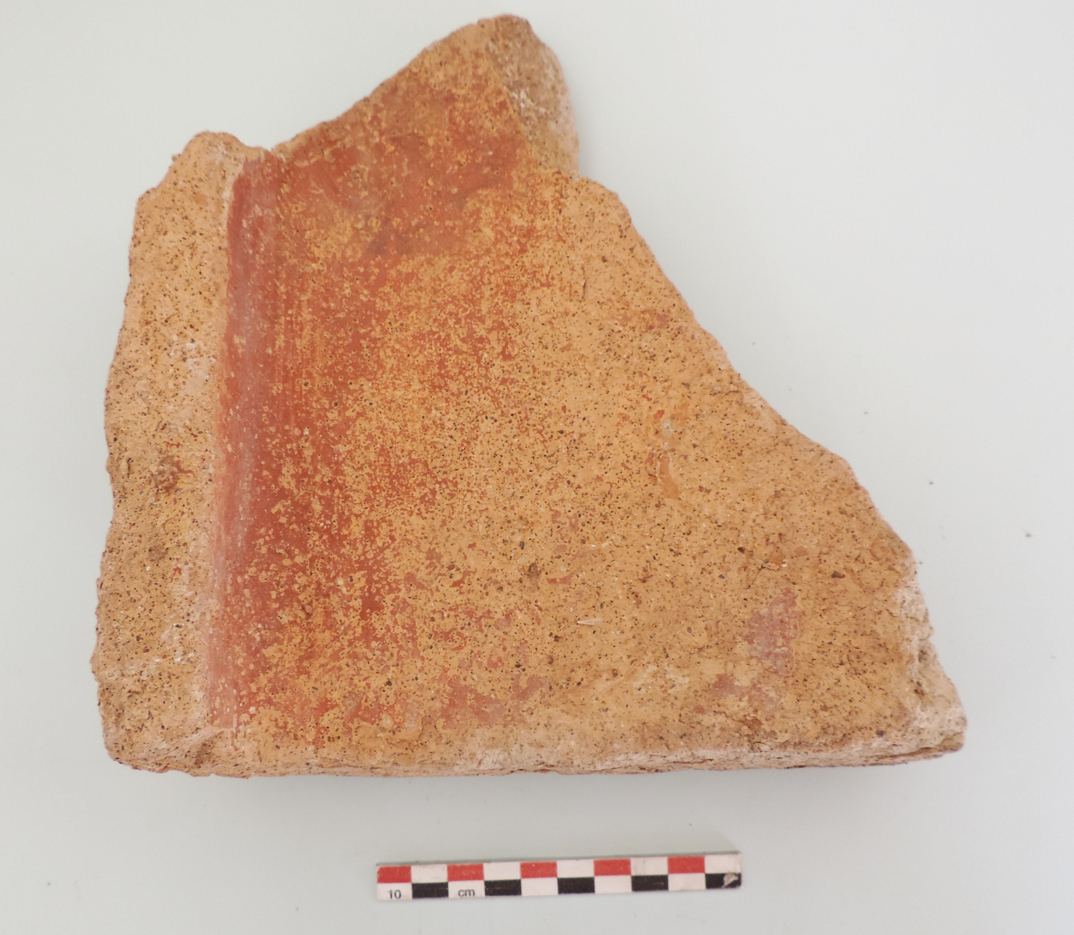 Fig. 16 - Rooftile fragment with painted decoration