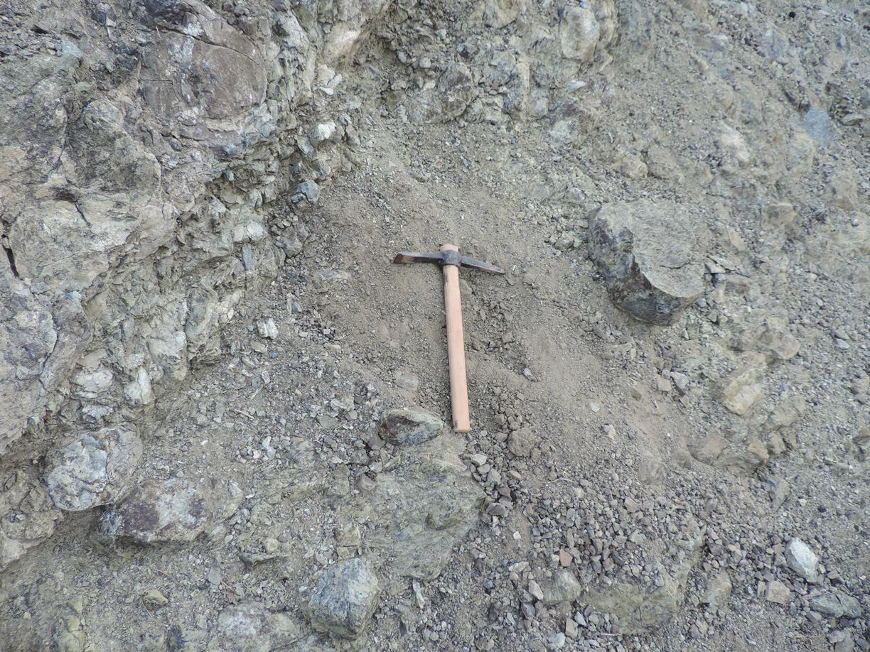 Fig. 9 - Taking sample from an ophiolite formation