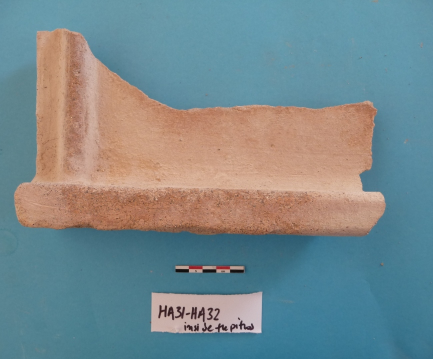 10. Part of a roof tile from HA31-HA32