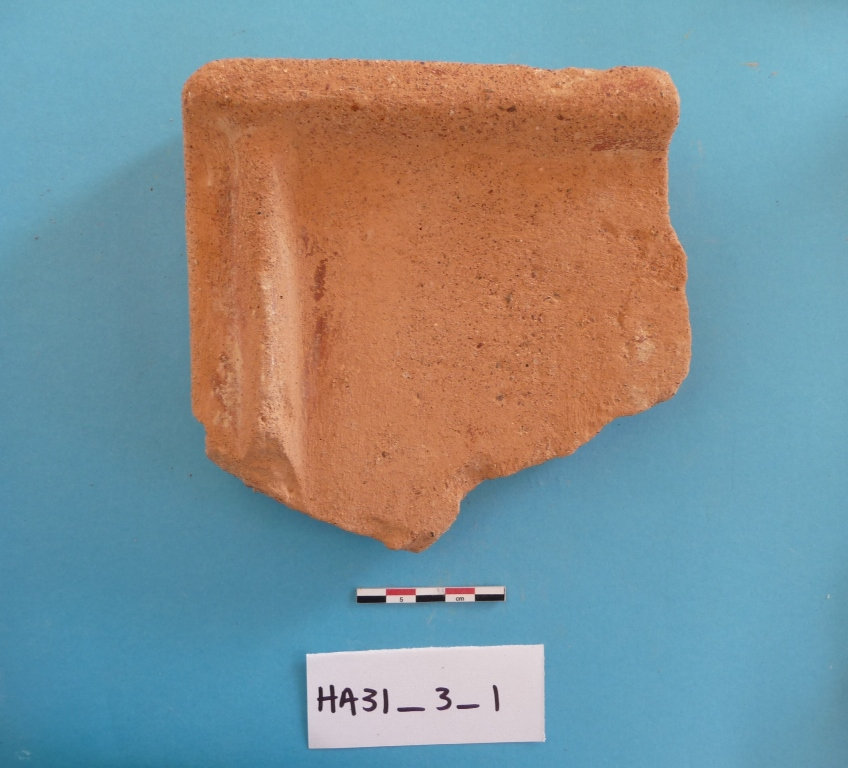 9. Part of a roof tile from HA31